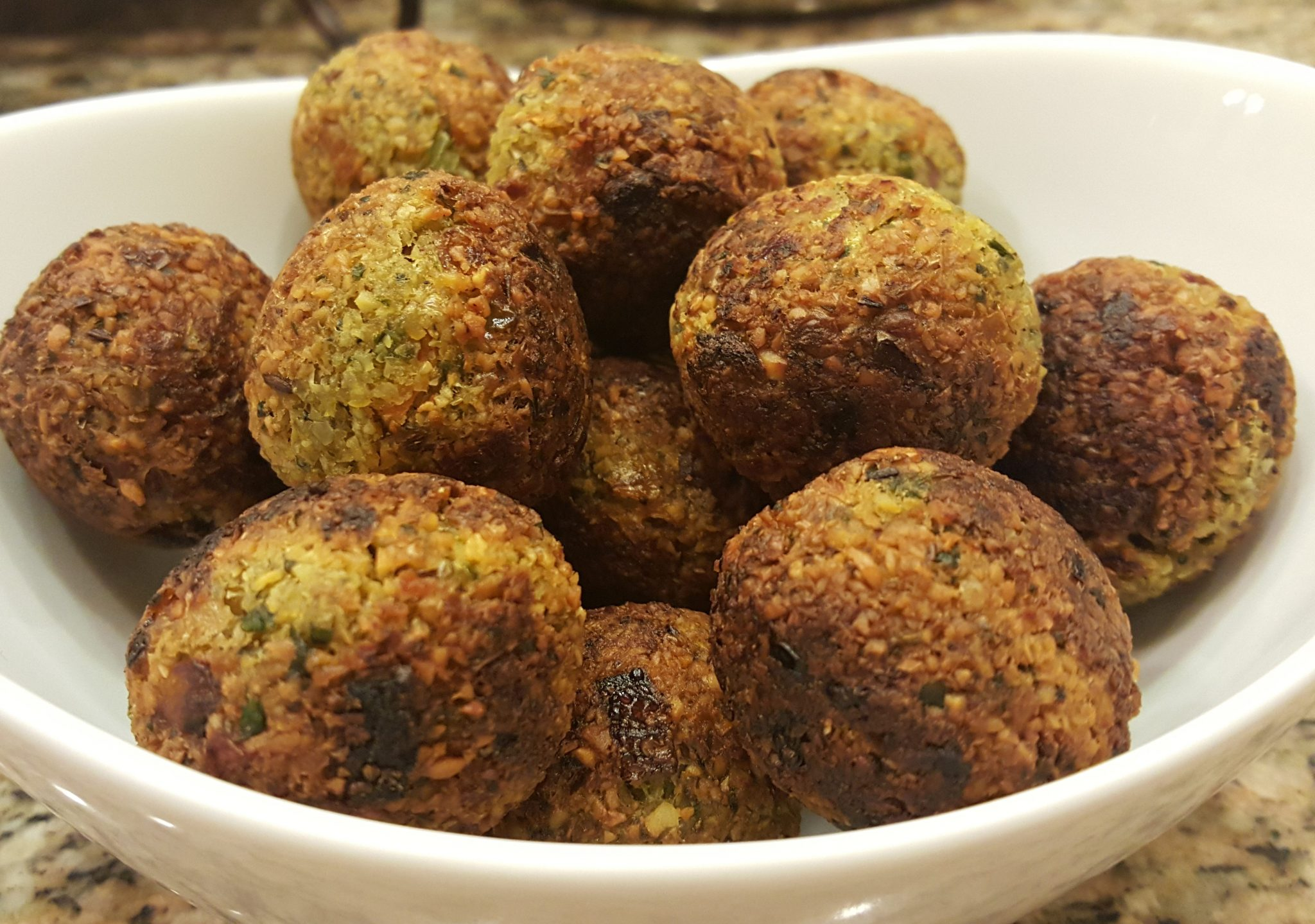 Falafel - Ebelskiver / Appe Pan Recipe from Enhance Your Palate - A healthier way of cooking chickpea falafel using appe pan or ebelskiver pan. You can have it just as a snack or make a sandwich or wrap. Kids love it!