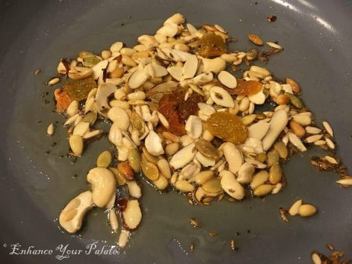 Nuts being sauted in a pan for masala oats