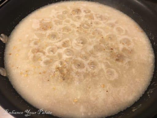 Oats simmering in a wok