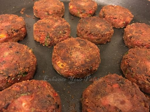 Flipping quinoa patties during the frying process
