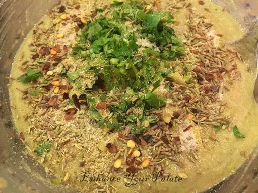 Mixing all ingredients to make batter for moong dal vada