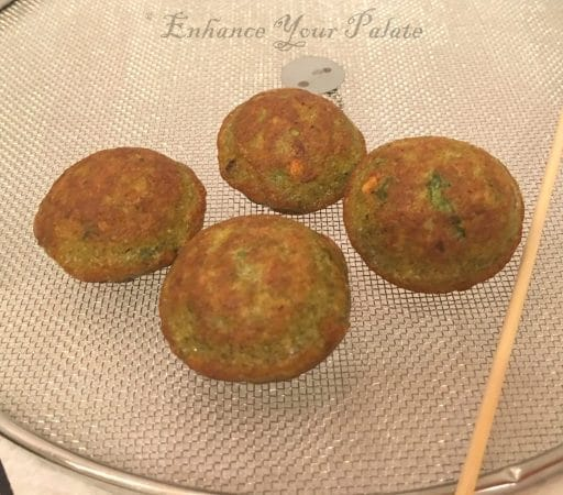 Moong dal vada or lentil fritters cooling down on mesh