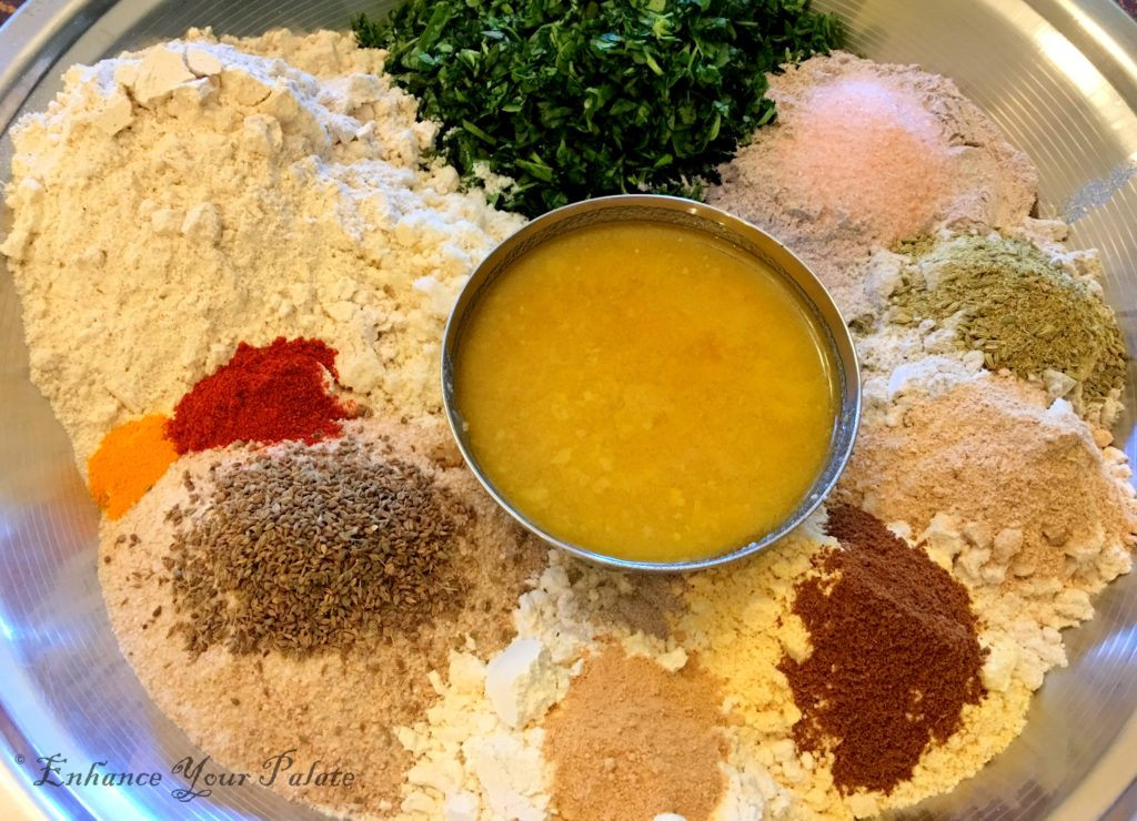 Different flours, sipces, fenugreek and other ingredients used in making the multigrain baked methi mathri.