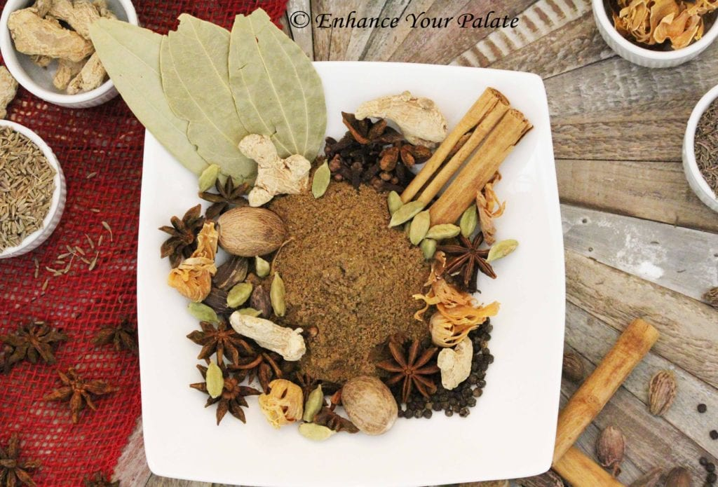 Picture showing homemade garam masala and recipe ingredients.