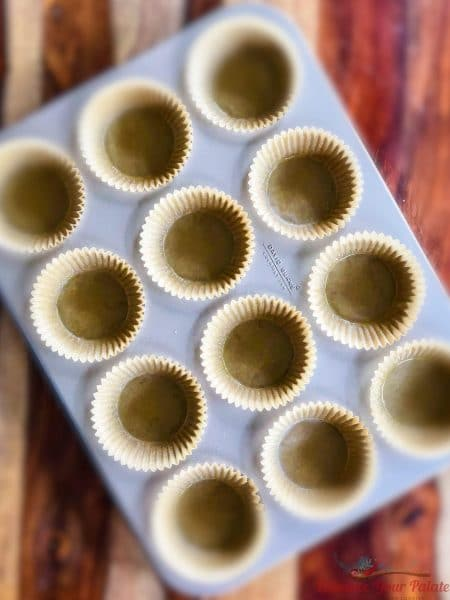 Buttered muffin pan for making Spinach Muffins