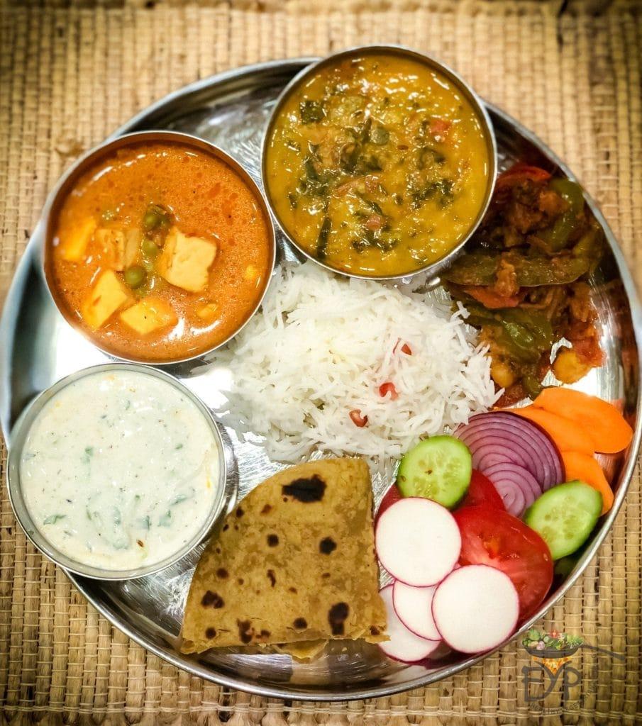 Indian Thali - Palak Dal - Spinach Lentil Soup; Matar Paneer; Aloo Shimla Mirch ; Cucumber Raita; Avocado Chapati; Steamed Rice and Vegetable salad