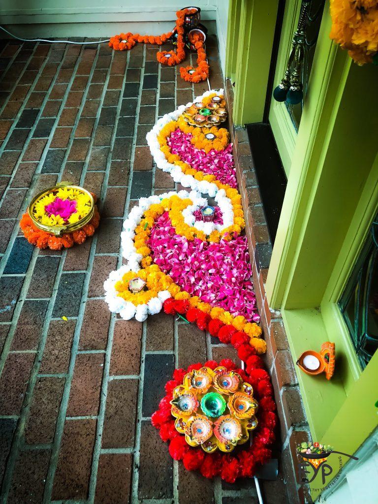 Festive Diwali Home Decor for Main Entrance using flower Rangoli and Diyas