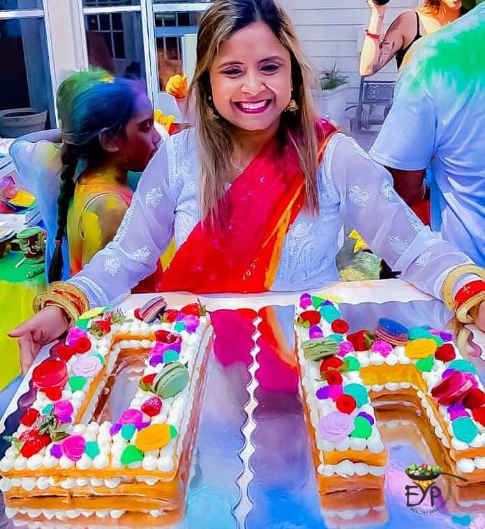 Rupali holding the birthday cake