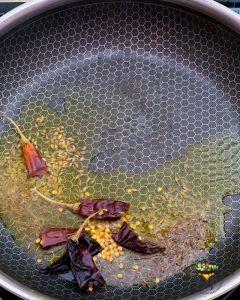 spices being cooked in oil