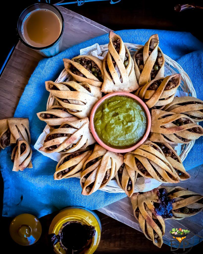 Baked samosa filled with spiced potato filling beautifully served with cilantro mint green chutney and chai.