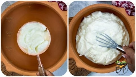 greek yogurt being whisked in a clay bowl
