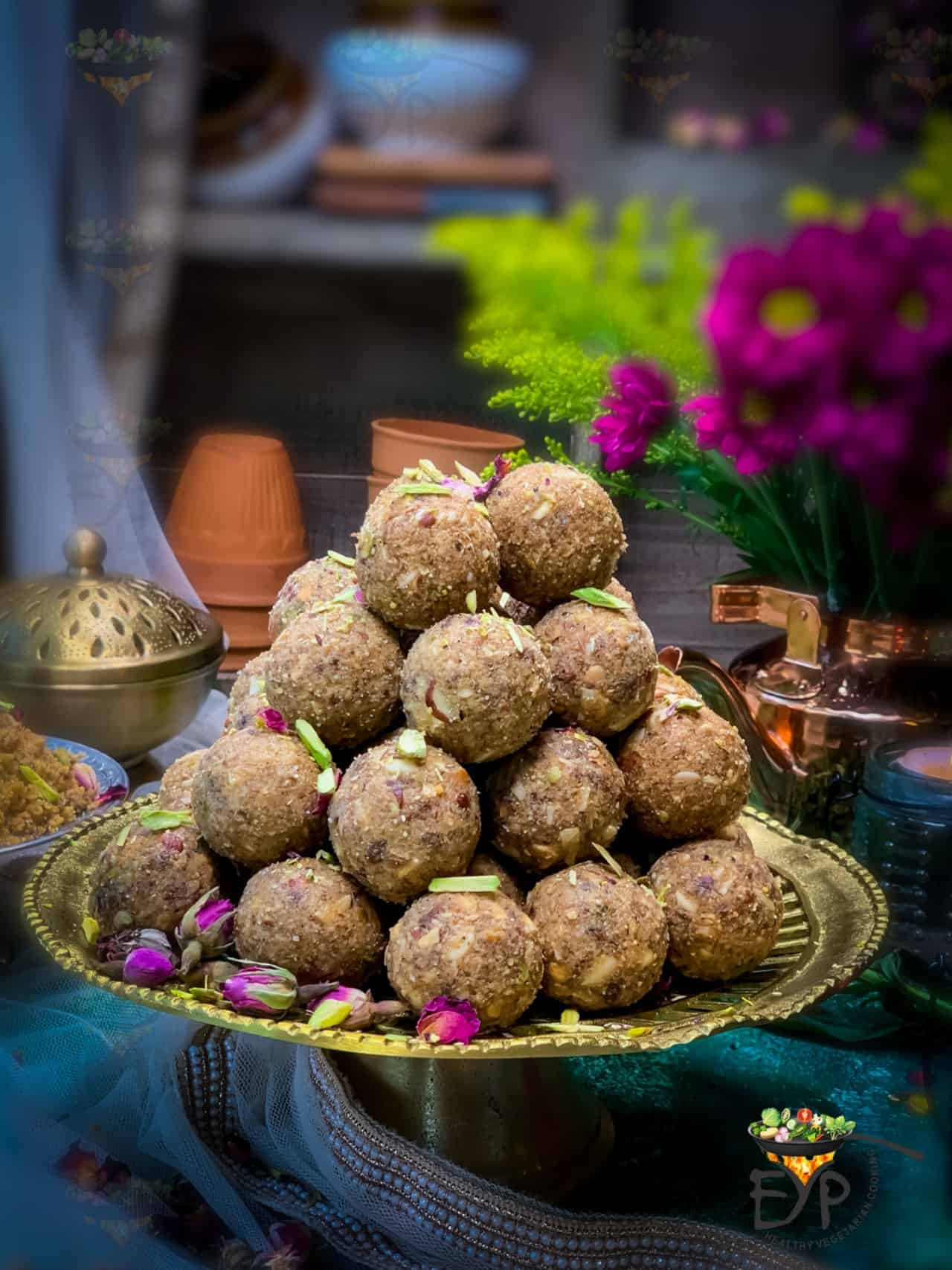 Stacked Churma Ladoo served on a brass plate stand