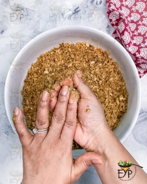 making churma ladoo with hands