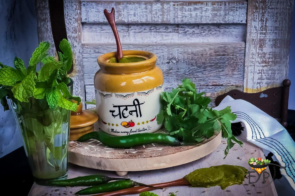 Cilantro Mint Green Chutney in a ceramic jar with chutney written in hindi