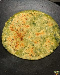 partially cooked paratha from one side