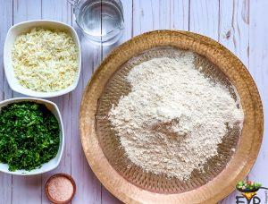 flour with ingredients to be mixed for making cilantro paneer dough