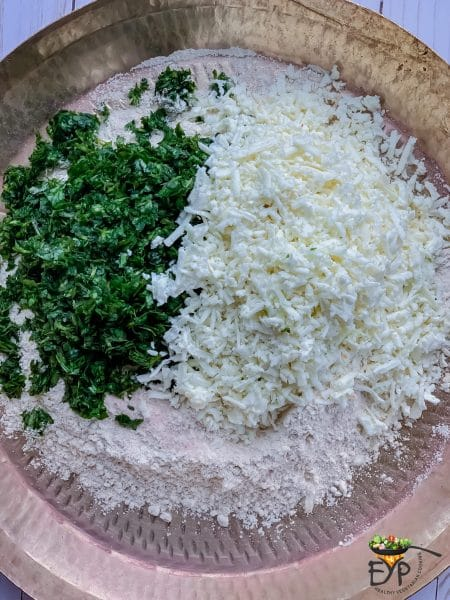 Paneer and Cilantro being mixed in dough