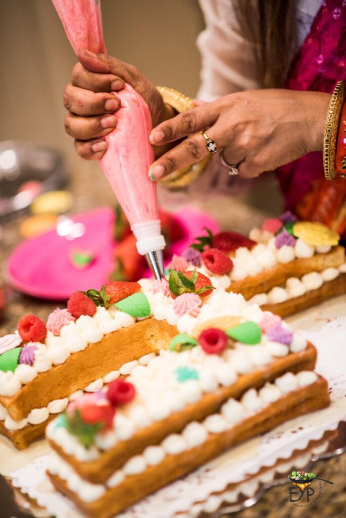 Rupali decorating the birthday cake