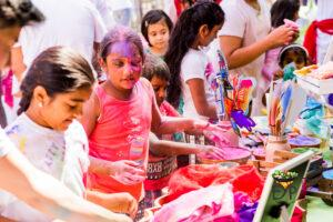 Kids watching the Holi colors very excitedly