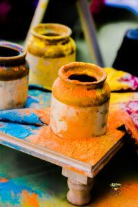 Empty ceramic jars that were originally filled with colors