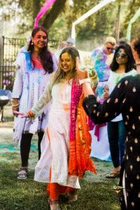 Pretty girl dancing on bollywood music during Holi celeberation