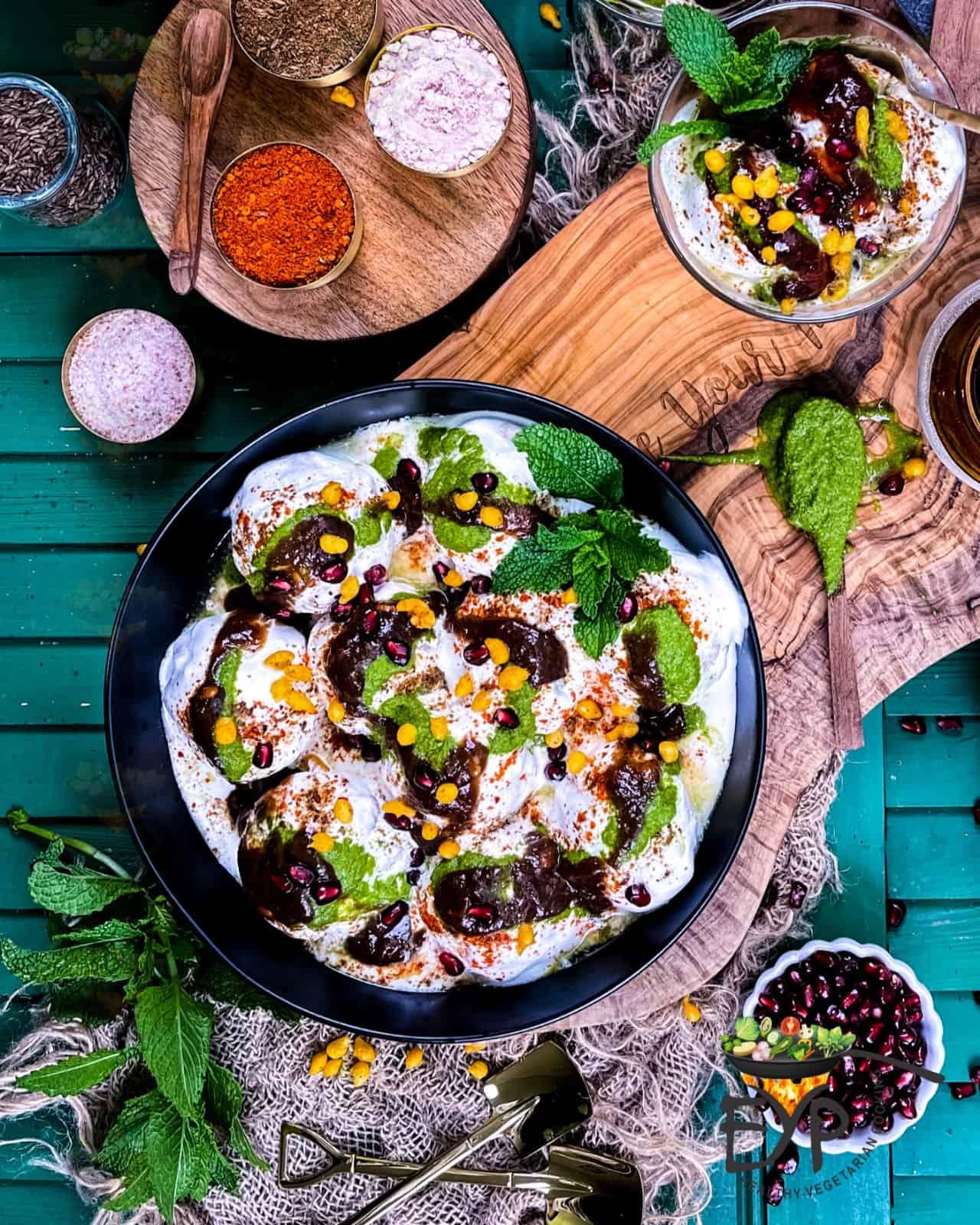Dahi Bhalla served in a bowl with chutneys