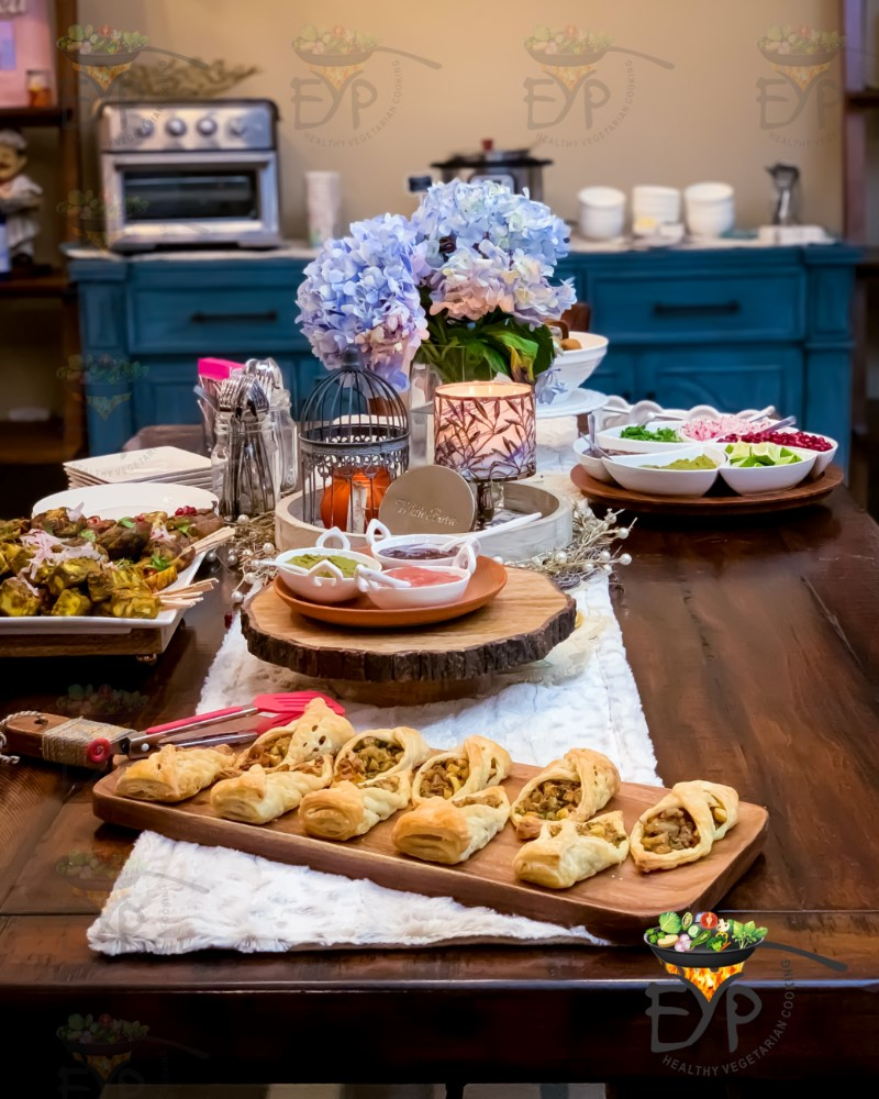 Thanksgiving appetizer table with baked samosa in the front,