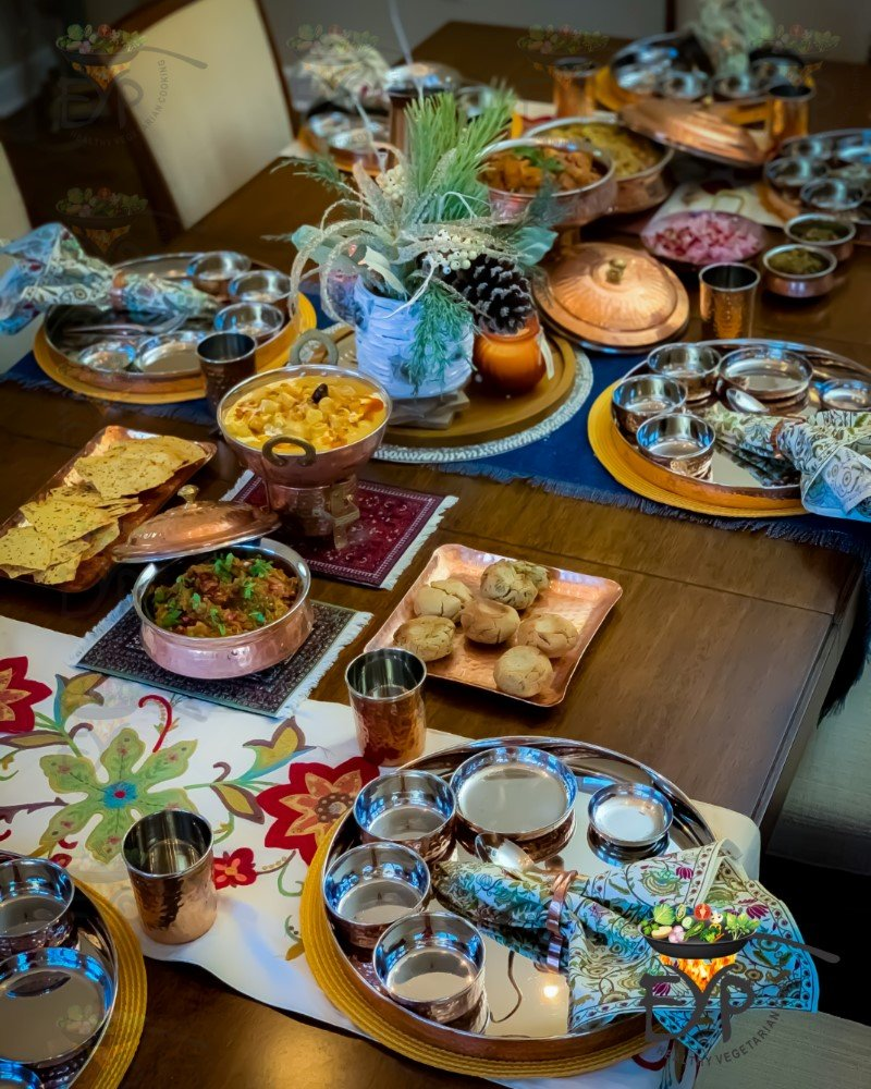 Dal Bati Churma party menu served for thanksgiving dinner on beautifully decorated table with copperware - Thanksgiving Table Decor