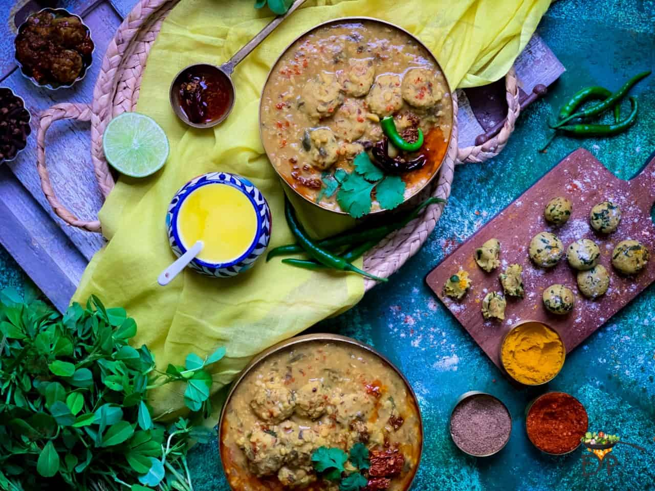 Rajasthani Dal dhokli served with ghee, lemon and chillies