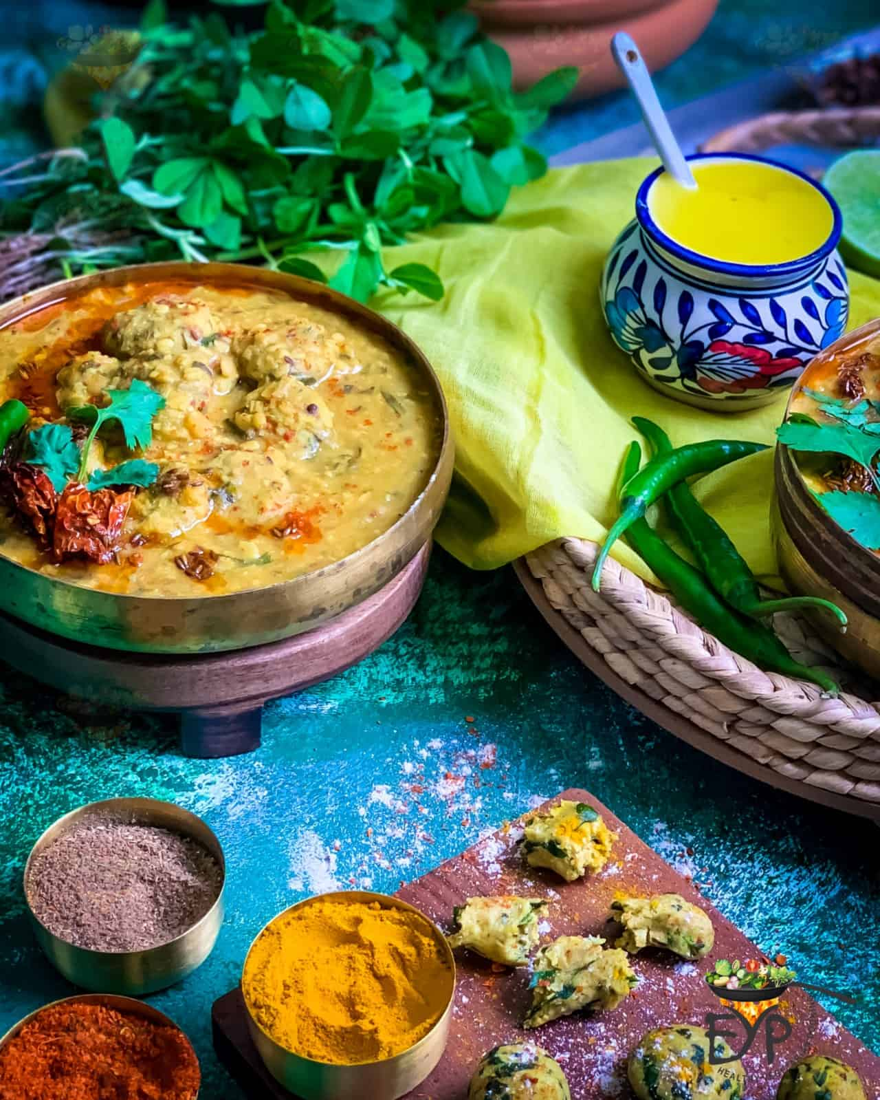 Dal Dhokli served in a copper bowl with ghee