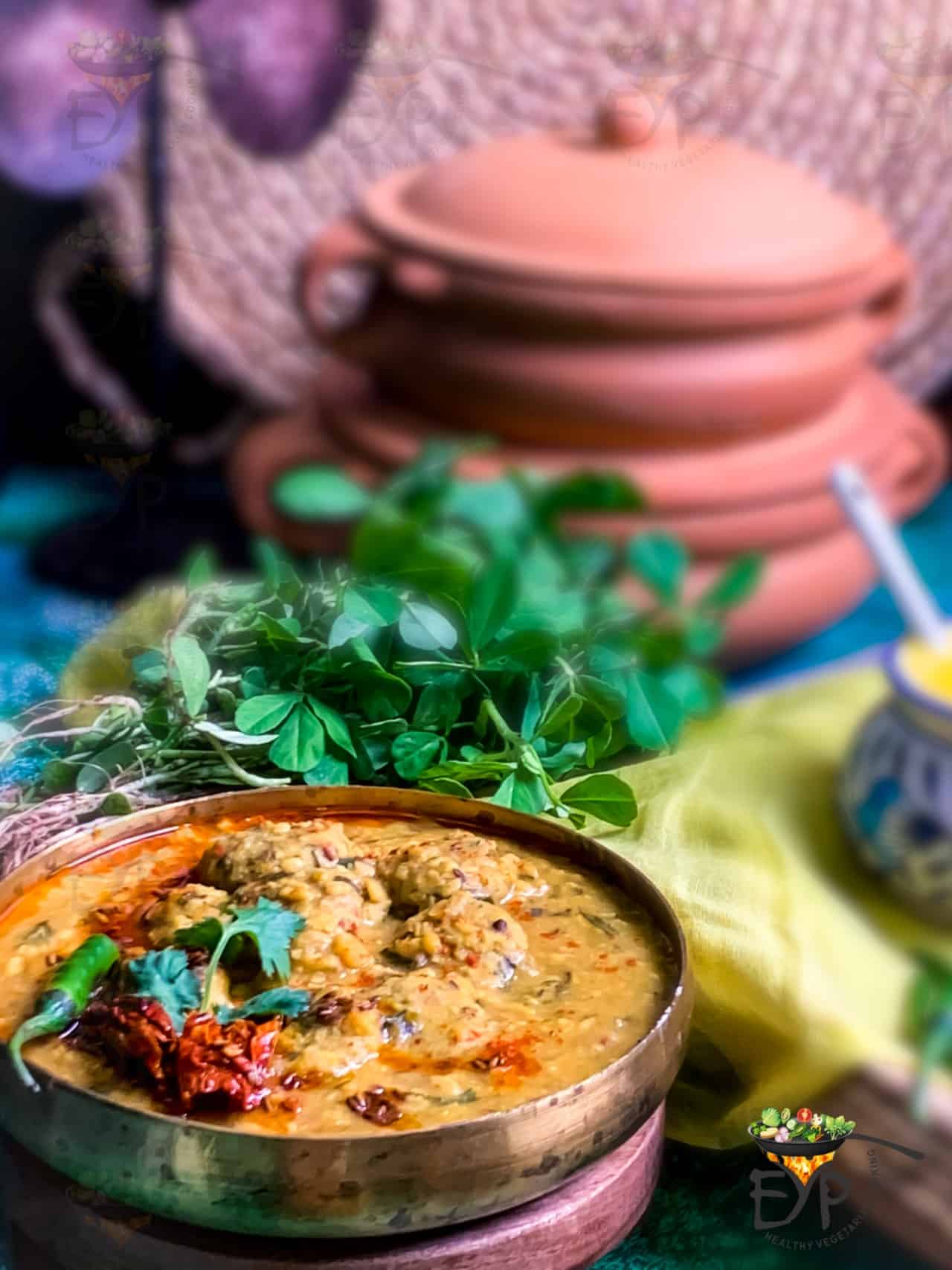 Rajasthani dal dhokli with methi leaves in the background
