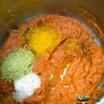 Spices being added to dal makhani tomatoe gravy