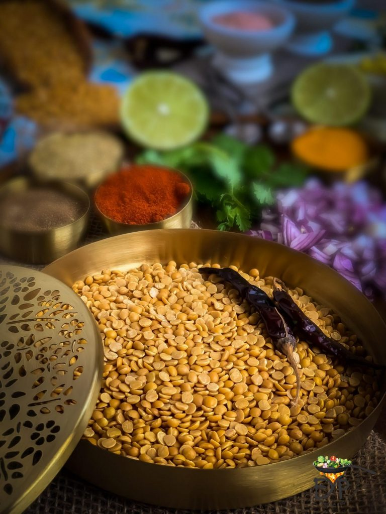 Toor Dal, Arhar Dal, Split Peigon Peas served in a brass bowl