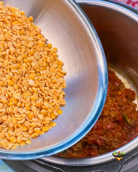 Washed lentils being added to pot