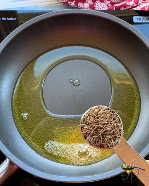 Adding jeera for tadka