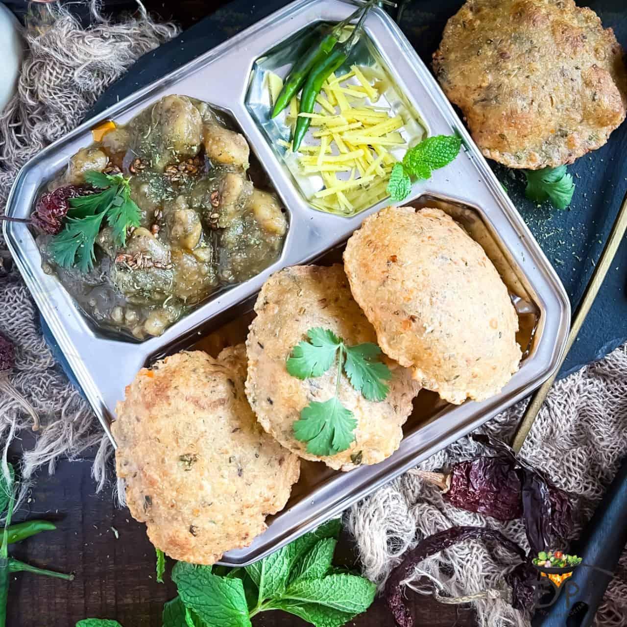 Dubki Wale Aloo: No Onion No Garlic Indian Spicy Potato Curry served with bhedai (deepfried lentil stuffed bread)