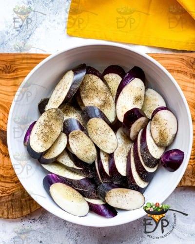seasoned eggplant ready for air-fryer tray