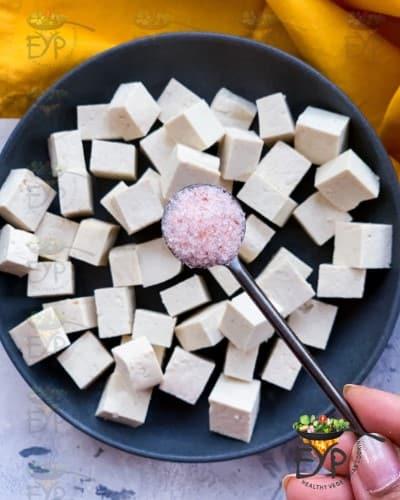 Salt being sprinkled on Tofu
