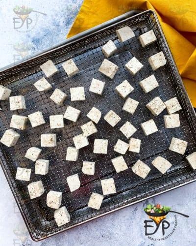 seasoned tofu on air-fryer basket
