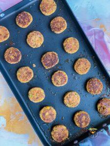 Falafel patties being pan fried
