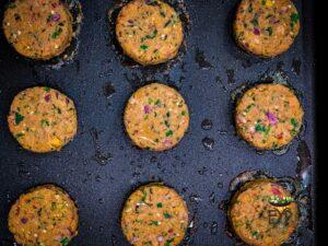 Falafel patties being pan-fried