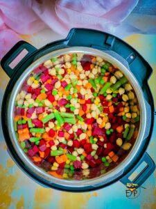 Soaked chickpeas in pressure cooker with vegetables
