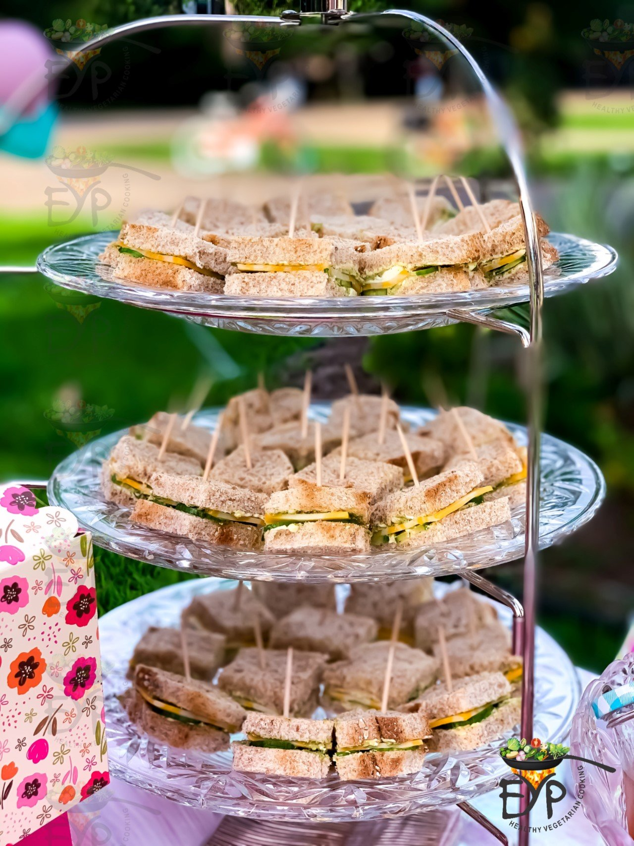 Tea time cucumber sandwiches served on a 3 tier server platter