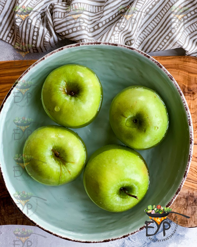 Whole Green apples in a bowl
