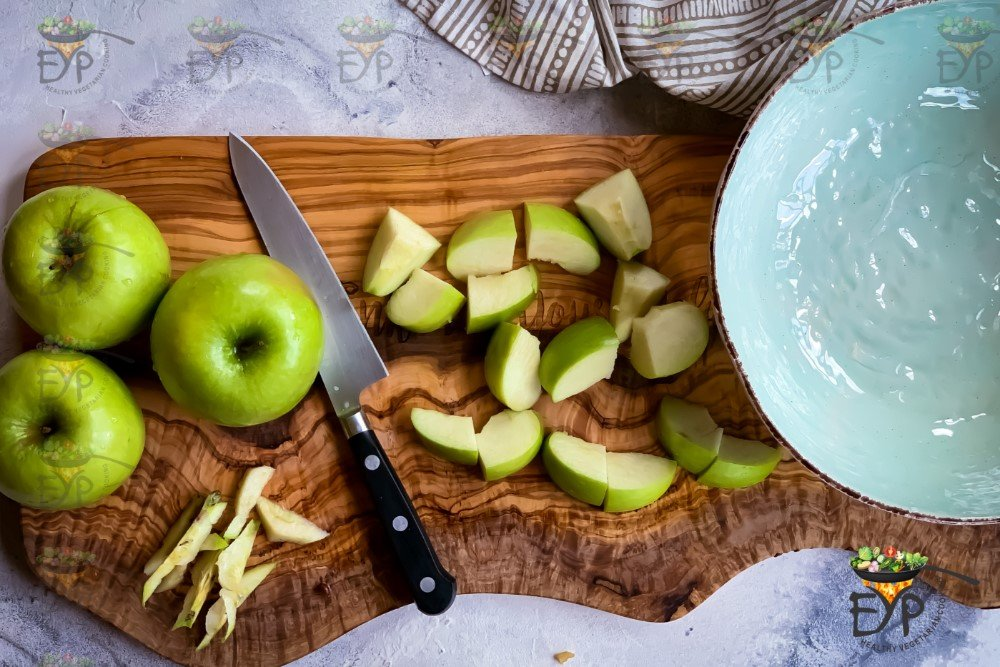 Green Apples being cut into slices