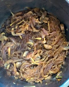 Half cooked noodle with onions and mushrooms
