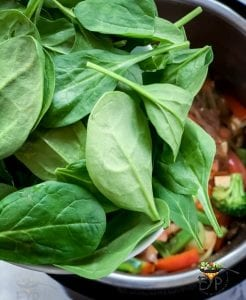 Spinach being added to Japchae recipe