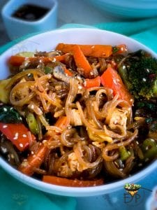 Japchae beautifully served in a bowl