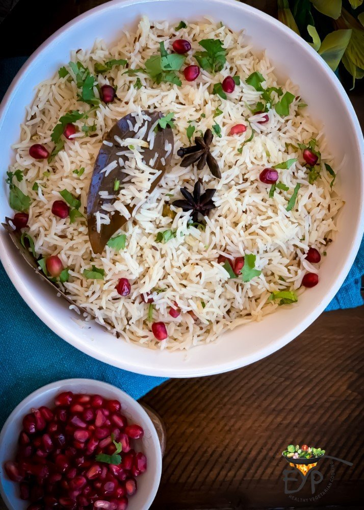 Jeera rice topped with Cilantro and Pomegranate Arils