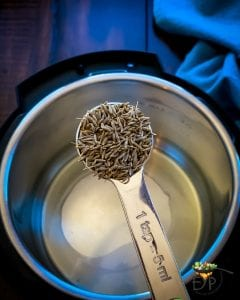 cumin seeds being added